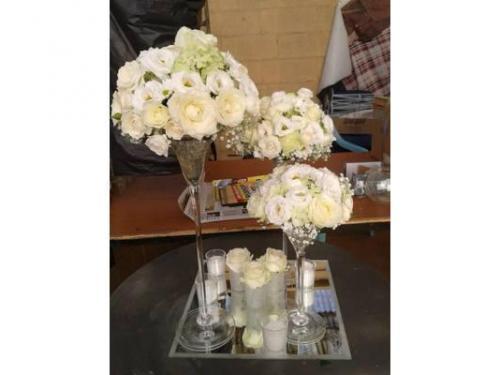 Centritavola coppa martini con candele e fiori alla base